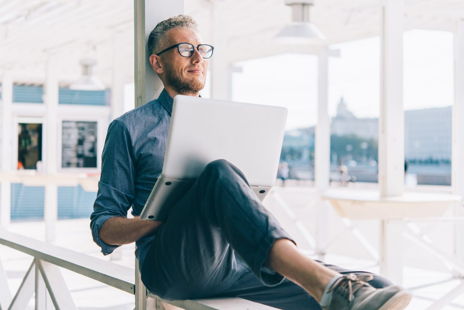 mature man doing addiction counselling on laptop