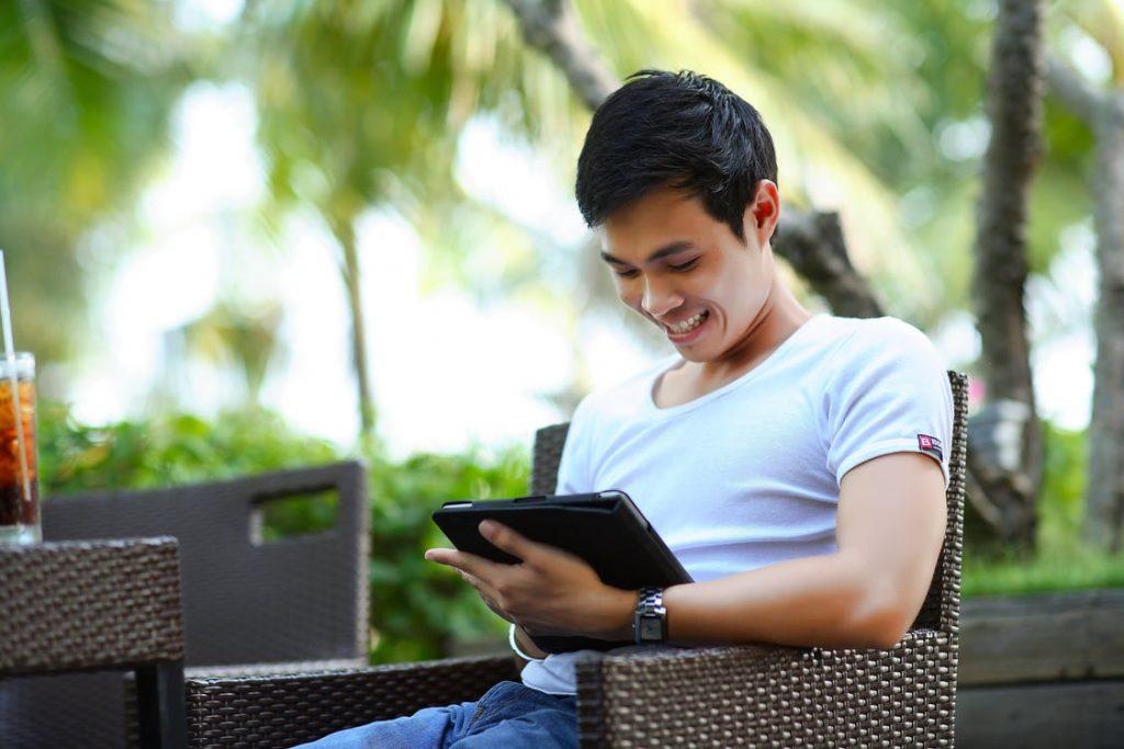 man interacts on iPad
